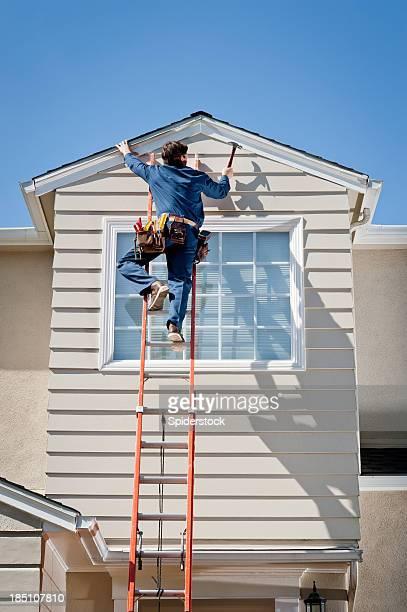 Handyman In Uniform Hammering