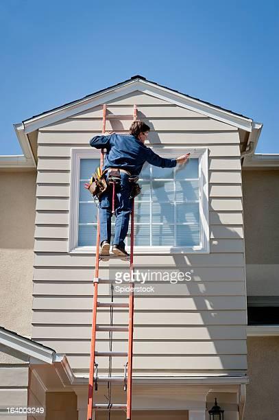 Handyman In Uniform Inspecting