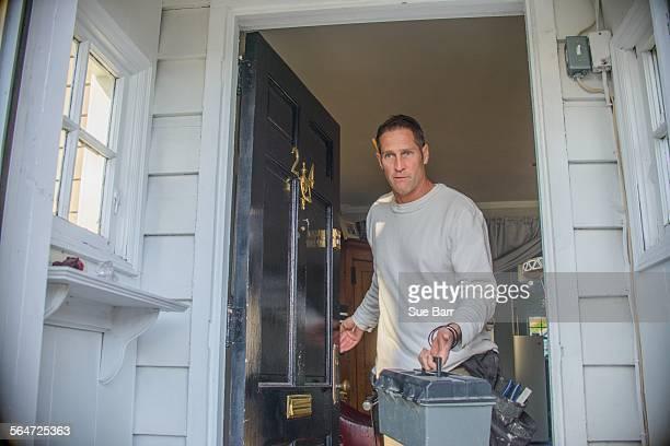 Handyman leaving house