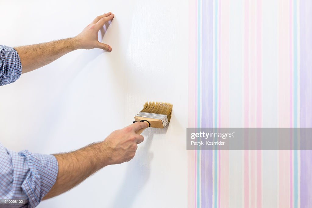 Handyman Putting Up Wallpaper High Res Stock Photo Getty Images