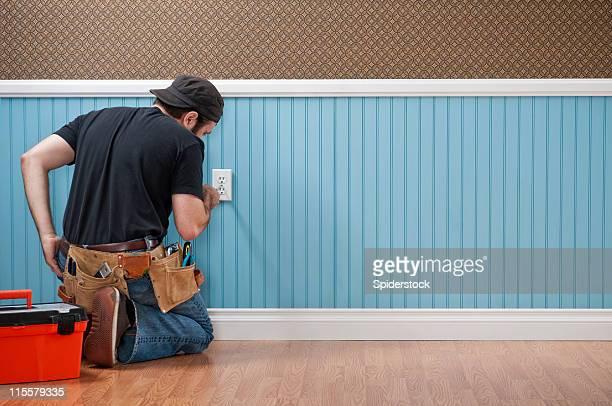 Handyman Working In Empty Room