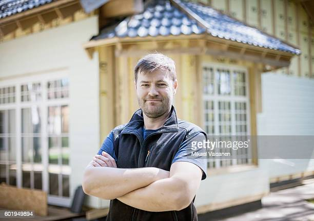 handyman working on his own house