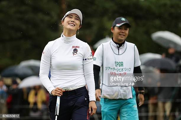 HaNeul Kim of South Korea celebrates after a winning putt on the 18th green during the final round of the LPGA Tour Championship Ricoh Cup 2016 at...