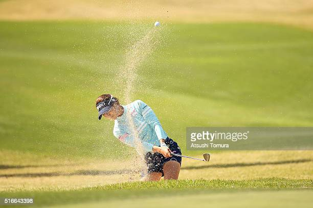 Ha-Neul Kim of South Korea hits from a bunker on the 18th hole during the T-Point Ladies Golf Tournament at the Wakagi Golf Club on March 20, 2016 in...