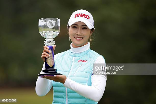 Ha-Neul Kim of South Korea lifts the Championship's trophy during a ceremony following the LPGA Tour Championship Ricoh Cup 2016 at the Miyazaki...