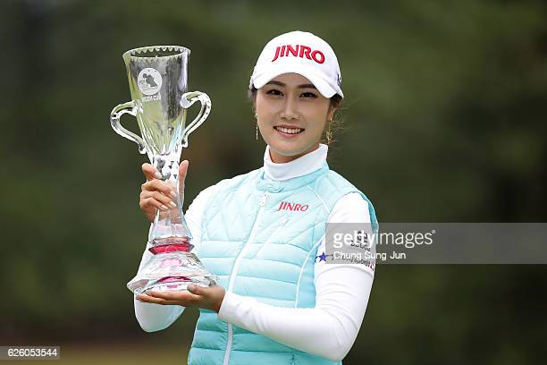 HaNeul Kim of South Korea lifts the sponsor's Ricoh Cup trophy during a ceremony following the LPGA Tour Championship Ricoh Cup 2016 at the Miyazaki...
