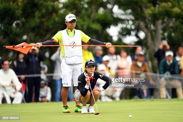 Ha-Neul Kim of South Korea lines up her putt on the 8th hole during the first round of Stanley Ladies Golf Tournament at the Tomei Country Club on...