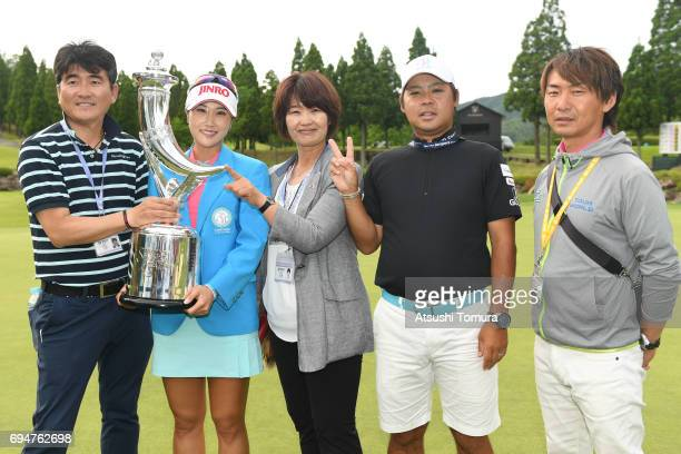 HaNeul Kim of South Korea pose with her team mates after winning the Suntory Ladies Open at the Rokko Kokusai Golf Club on June 11 2017 in Kobe Japan