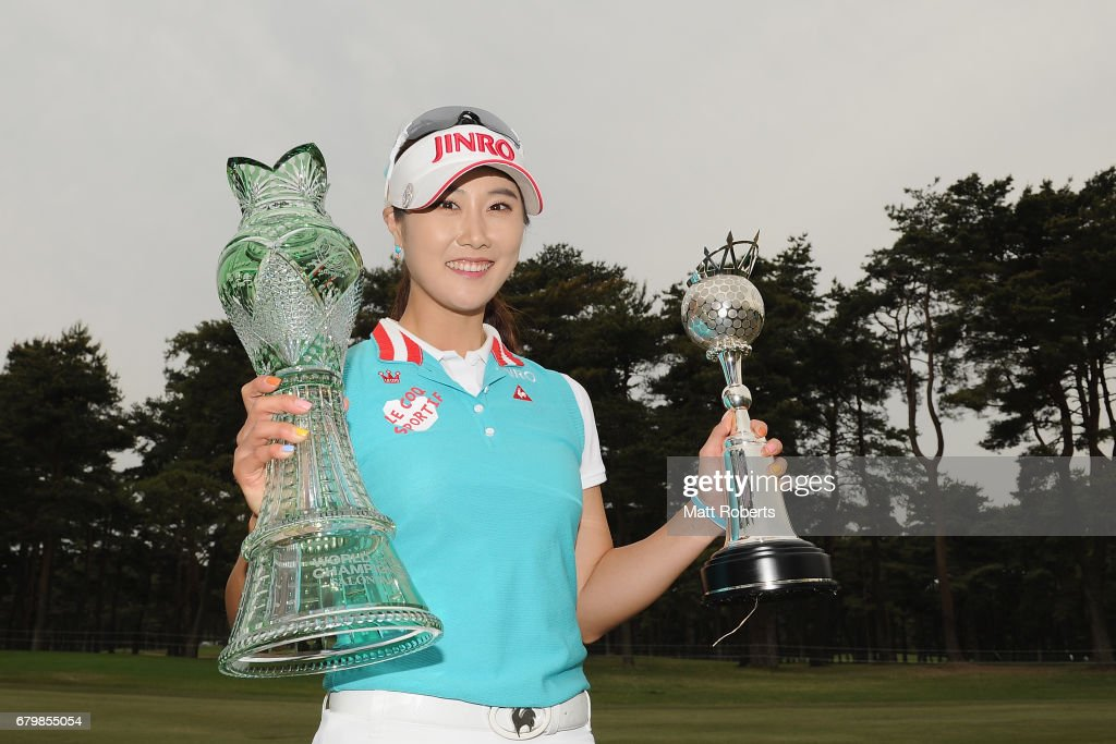 Ha-Neul Kim of South Korea poses for a photo holding the winners trophy on the 18th green during the final round of the World Ladies Championship Salonpas Cup at the Ibaraki Golf Club on May 7, 2017 in Tsukubamirai, Japan.