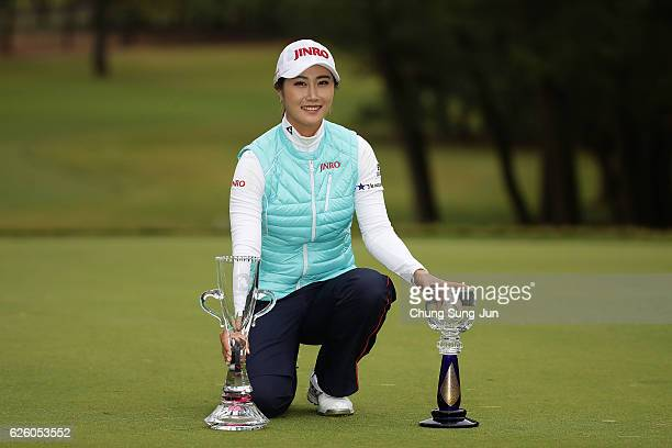HaNeul Kim of South Korea poses with the Championship's trophy and sponsor's Ricoh Cup trophy during a ceremony following the LPGA Tour Championship...