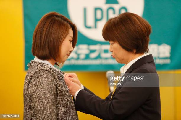 HaNeul Kim of South Korea receives a lapel pin from LPGA president Hiromi Kobayashi during the Ladies Professional Golfers' Association of Japan...