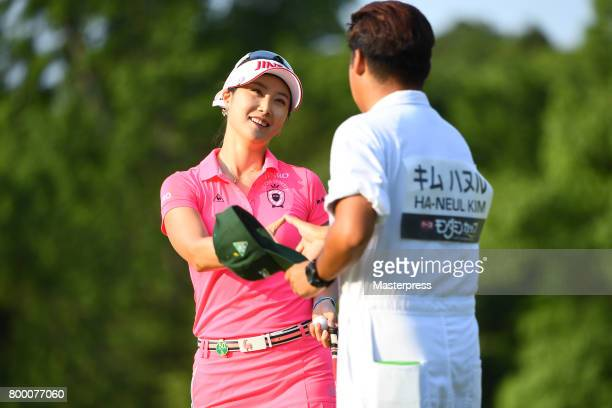 HaNeul Kim of South Korea shake hands with her caddie after the second round of the Earth Mondamin Cup at the Camellia Hills Country Club on June 23...