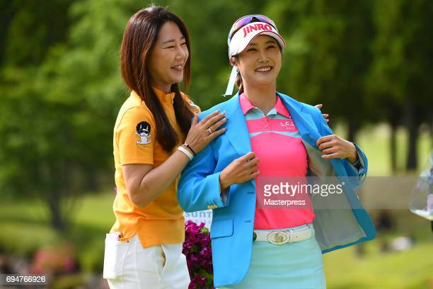 HaNeul Kim of South Korea smiles after winning the Suntory Ladies Open at the Rokko Kokusai Golf Club on June 11 2017 in Kobe Japan
