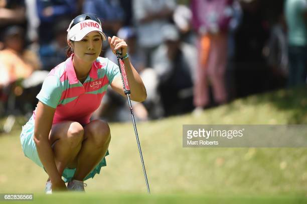 HaNeul Kim of South Korea waits to putt on the 14th green during the final round of the HokennoMadoguchi Ladies at the Fukuoka Country Club Wajiro...