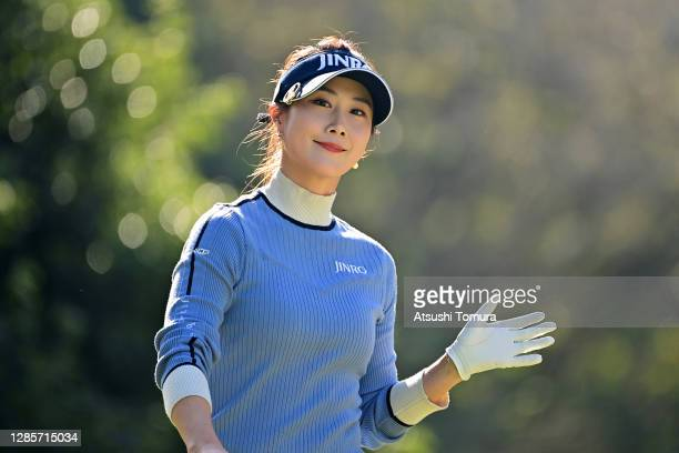 Ha-Neul Kim of South Korea waves after her tee shot on the 6th hole during the final round of the Ito-En Ladies Golf Tournament at the Great Island...