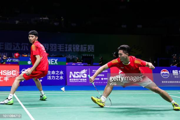 Hang Chengkai and Zhou Haodong of China compete in the Men's Doubles second round match against Marcus Fernaldi Gideon and Kevin Sanjaya Sukamuljo of...