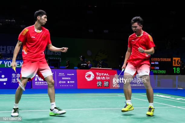 Hang Chengkai and Zhou Haodong of China react in the Men's Doubles second round match against Marcus Fernaldi Gideon and Kevin Sanjaya Sukamuljo of...