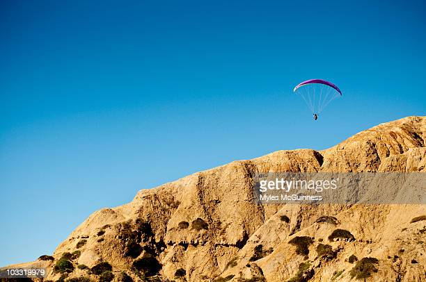 A hang glider floats above the cliffs of Torrey Pines over La Jolla, California.