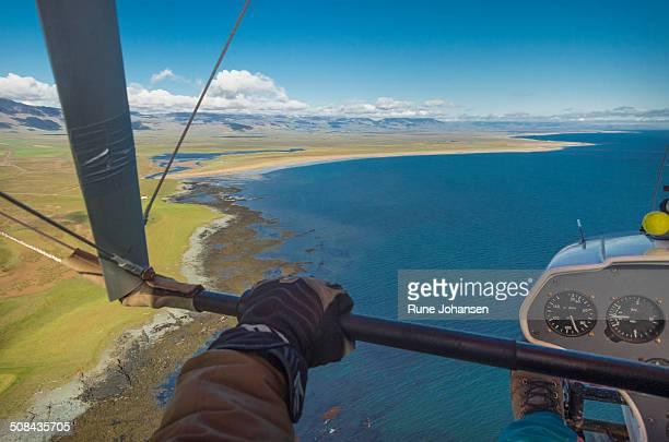 Hang Glider over Longufjorur Coastline