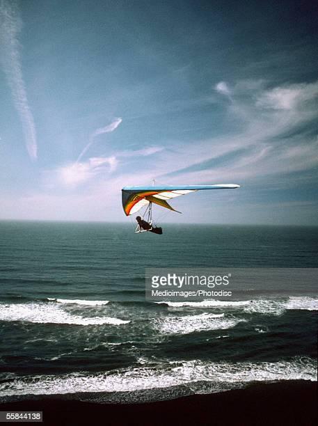 Hang glider over the ocean