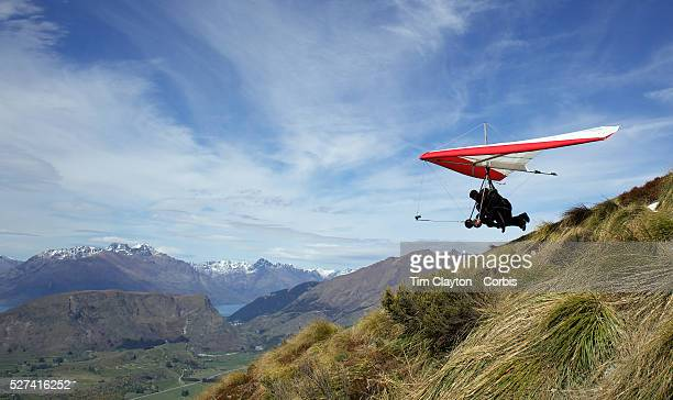 Hang Glider pilot Angus Tapper takes off with tourist Arjun Sharma from New York during a tandem Hang Glider flight from Coronet Peak Queenstown New...