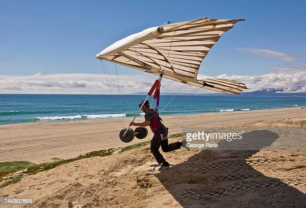 A hang glider takes off from a bluff at Dockweiler State Beach in El Segundo on April 26 2012 in Los Angeles California Millions of tourists flock to...