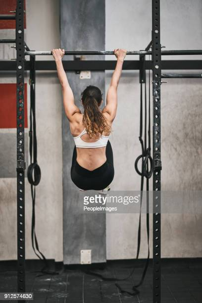 hang on and keep going and achieve your fitness goal - center athlete stock photos and pictures