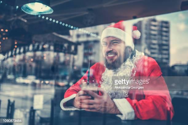 Hang Over Santa Drinking Coffee At The Bar