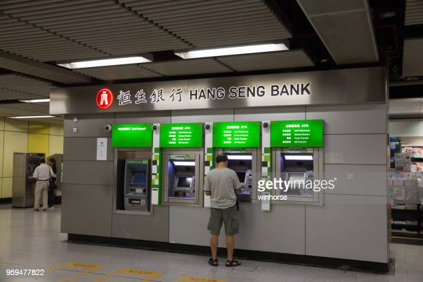 hang seng bank in mtr station, hong kong - hang seng index stock pictures, royalty-free photos & images