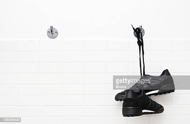hang up soccer shoes - locker room stock pictures, royalty-free photos & images