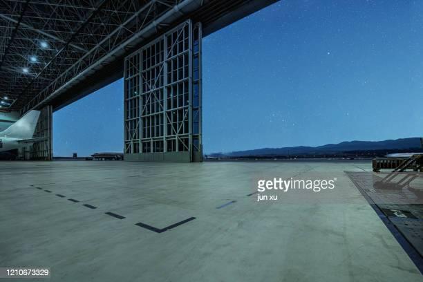 hangar runway under the stars - 工業設備 ストックフォトと画像