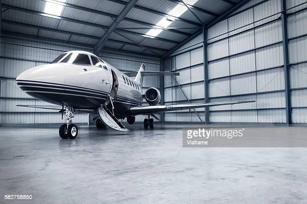 Hangar with jet