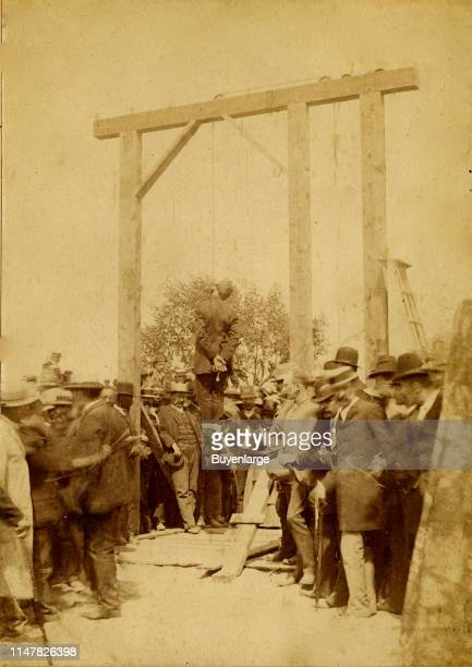 Hanged Man - A Large Group Of Men And At Least One Woman Surrounding The Gallows Where The Dead Man Hangs. Denver Hanging In 1887.