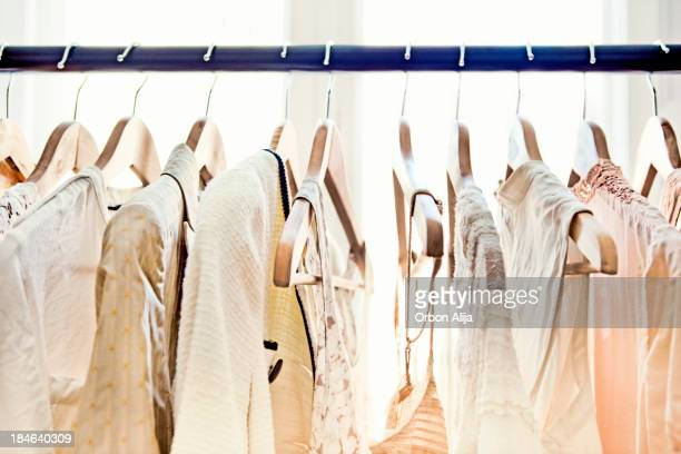 hangers with clothes - rack stock pictures, royalty-free photos & images