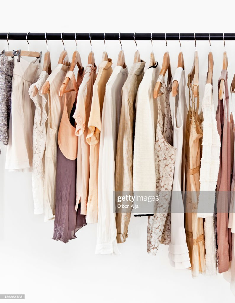 Hangers with clothes : Stock Photo