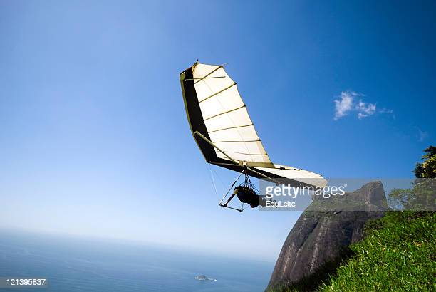 hang-gliding - leap of faith stock photos and pictures