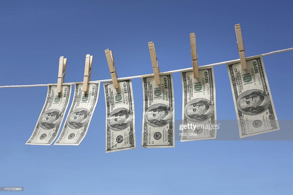 Hanging $100 bills : Stock Photo
