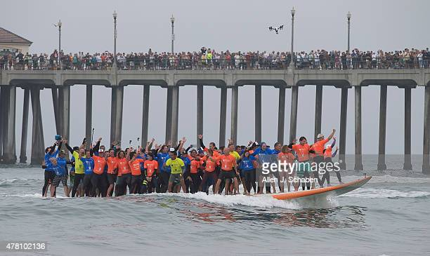 Hanging 600 Crowds gather on the pier and the beach to watch surfing history being made as 66 surfers break the World Guinness Record for most people...