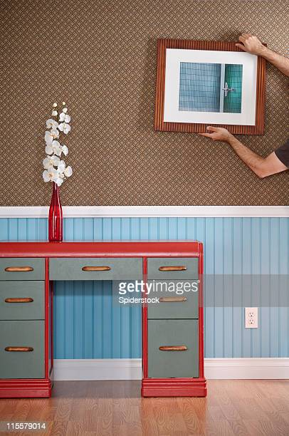 hanging a photograph - art deco stock pictures, royalty-free photos & images