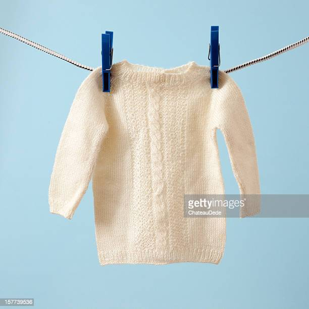 hanging baby sweater - jumper stock pictures, royalty-free photos & images