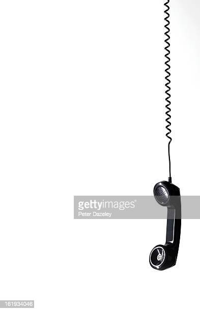 Hanging black phone with copy space