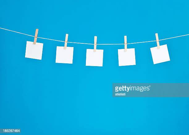 hanging blank note pads - clip stock pictures, royalty-free photos & images