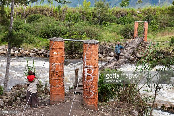 Hanging Bridge over Wamena River Baliem Valley West Papua Indonesia