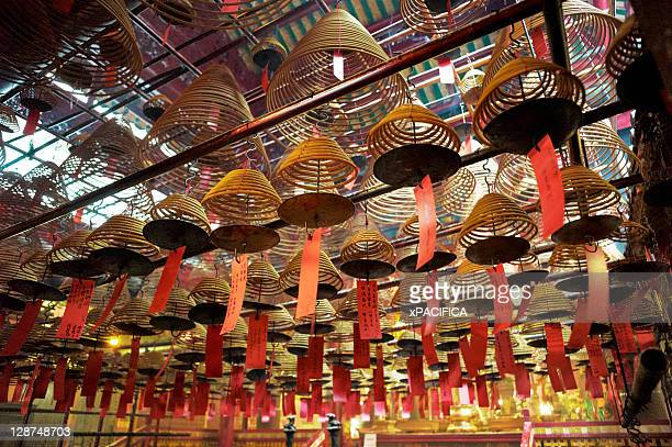 hanging coils of incense in a chinese temple - incense coils stock pictures, royalty-free photos & images