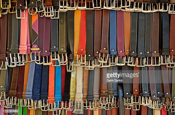 Hanging colorful leather belts