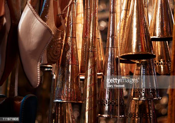 hanging copper trumpets and slippers in a souk - yeowell foto e immagini stock
