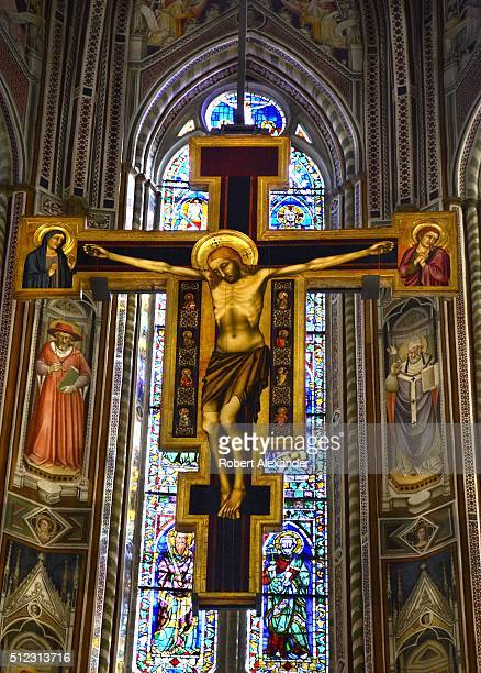 Hanging in the nave of the Basilica of Santa Croce in Florence Italy is the Crocifisso Cimabue a crucifix painted by Florentine painter Cimabue in...