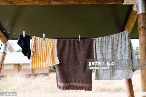 hanging laundry on a clothesline - kamperen stock pictures, royalty-free photos & images