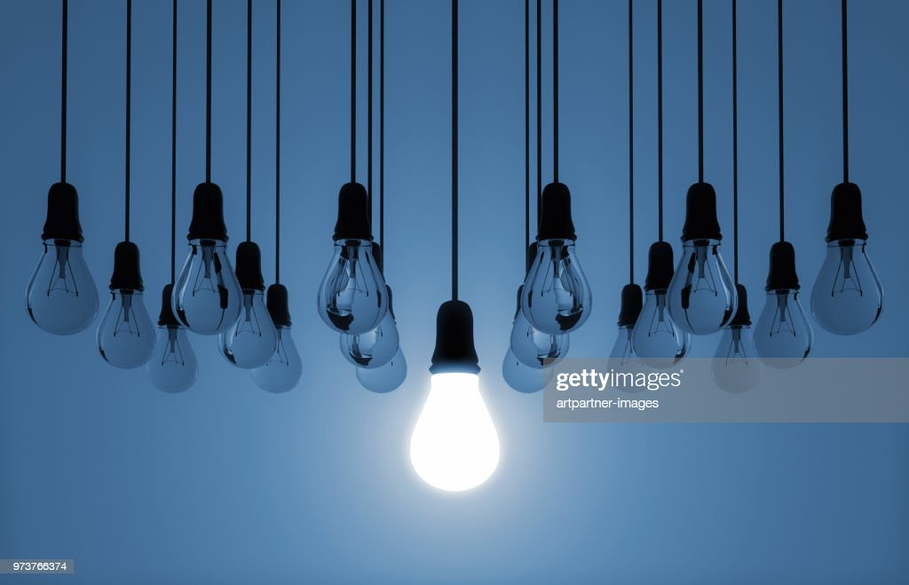 hanging light bulb switched on : Stock Photo