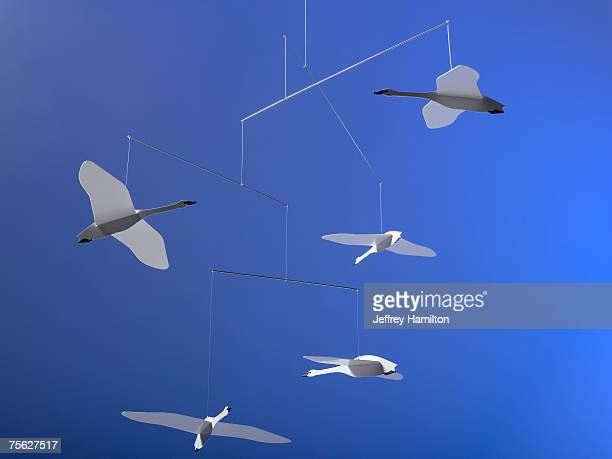 hanging mobile with origami geese - mobile stockfoto's en -beelden